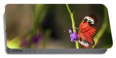 Butterfly Landing On Purple Flower Portable Battery Charger