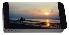 Camel Walking Along The Shoreline At Sunset In Egypt Portable Battery Charger