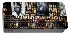 Portable Battery Charger featuring the photograph Choir Boy's Red Bicycle by Craig J Satterlee