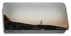 Church On Top Of A Hill And Under A Mountain, With The Moon In The Background. Portable Battery Charger