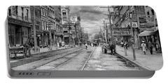 Portable Battery Charger featuring the photograph City - Poughkeepsie Ny - The Ever Changing Market Place 1906 - Black And White by Mike Savad