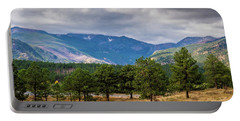 Portable Battery Charger featuring the photograph Clouds Over The Rockies by James L Bartlett