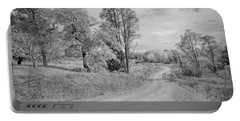 Portable Battery Charger featuring the photograph Country Road by John M Bailey