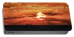 Portable Battery Charger featuring the photograph Dramatic Atlantic Sunrise With Ghost Freighter by Bill Swartwout Fine Art Photography