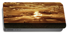 Portable Battery Charger featuring the photograph Dramatic Atlantic Sunrise With Ghost Freighter In Goldtone by Bill Swartwout Fine Art Photography