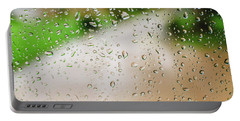 Drops Of Rain On An Autumn Day On A Glass. Portable Battery Charger