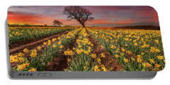 Field Of Daffodils Sunset Portable Battery Charger