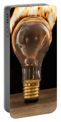 Portable Battery Charger featuring the photograph Fire And Flames Ignited Out Of Light Bulb by Vincent Billotto