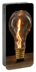Portable Battery Charger featuring the photograph Fire Sparks Inside A Light Bulb by Vincent Billotto