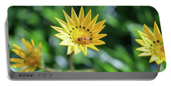 Yellow Flowers And A Bee Portable Battery Charger