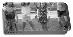 Four Girls, Jumping, 1972 Portable Battery Charger