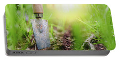 Gardening Shovel In An Orchard During The Gardener's Rest Portable Battery Charger