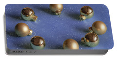 Golden Christmas Balls On The Snowy Background Portable Battery Charger
