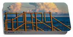 Portable Battery Charger featuring the photograph Golden Railings by Tom Gresham