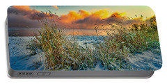Portable Battery Charger featuring the photograph Grass And Snow Sunrise by Tom Gresham