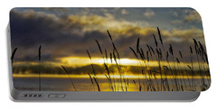 Portable Battery Charger featuring the photograph Grassy Shoreline Sunrise by Tom Gresham