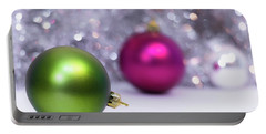 Portable Battery Charger featuring the photograph Green And Fuchsia Christmas Balls And Lights In Background. Wint by Cristina Stefan