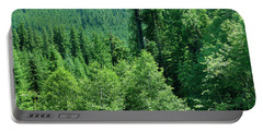 Green Conifer Forest On Steep Hillside  Portable Battery Charger