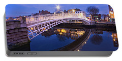 Portable Battery Charger featuring the photograph Ha'penny Bridge At Blue Hour by Barry O Carroll