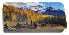 Portable Battery Charger featuring the photograph High County Ablaze by Rick Furmanek