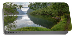 Portable Battery Charger featuring the photograph Hiking The Old Postal Road By The Naeroyfjord, Norway by Andreas Levi