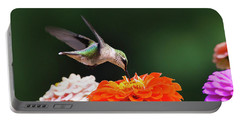 Portable Battery Charger featuring the photograph Hummingbird In Flight With Orange Zinnia Flower by Christina Rollo