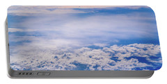 Intense Blue Sky With White Clouds And Plane Crossing It, Seen From Above In Another Plane. Portable Battery Charger