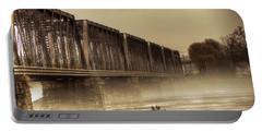 International Bridge Portable Battery Charger