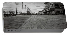 Portable Battery Charger featuring the photograph Low On The Boardwalk by Steve Stanger