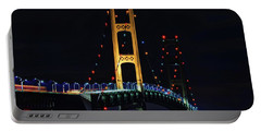 Portable Battery Charger featuring the photograph Mackinac Bridge Lit Up by Dan Sproul