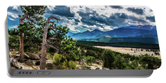Portable Battery Charger featuring the photograph Majestic Clouds by James L Bartlett