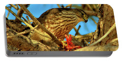 Portable Battery Charger featuring the photograph Merlin Eating Breakfast by Debbie Stahre