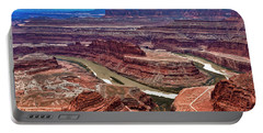 Portable Battery Charger featuring the photograph Moon Over Deadhorse Point by Andy Crawford