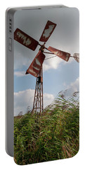 Portable Battery Charger featuring the photograph Old Rusty Windmill. by Anjo Ten Kate