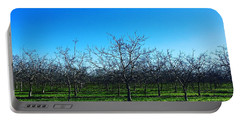 Orchard Trees In Blue Portable Battery Charger