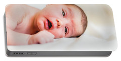 Portrait Of Newborn Baby Girl Feels Safe And Awake To A New Life. Portable Battery Charger