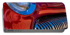 Portable Battery Charger featuring the photograph Red Car Chrome Grill by Tom Gresham