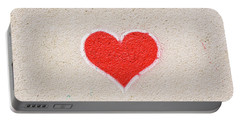 Red Heart Painted On A Wall, Message Of Love. Portable Battery Charger