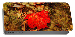 Red Leaf On Mossy Rock Portable Battery Charger