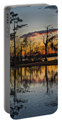 Portable Battery Charger featuring the photograph Riverside Sunset by Tom Gresham