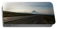 Portable Battery Charger featuring the photograph Road Through The Rockies by Nicole Lloyd