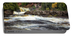 Portable Battery Charger featuring the photograph Roaring Gooseberry Falls by Susan Rissi Tregoning