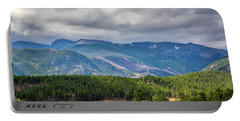 Portable Battery Charger featuring the photograph Rockies - Clouds by James L Bartlett