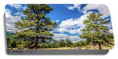 Portable Battery Charger featuring the photograph Rocky Mountain Highway by James L Bartlett