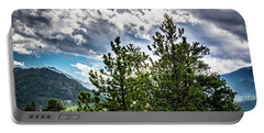 Portable Battery Charger featuring the photograph Rocky Mountain Pines by James L Bartlett