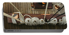 Ropes To Hold The Sails Of An Old Sailboat Rolled. Portable Battery Charger