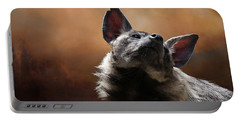 Portable Battery Charger featuring the photograph Scenting The Air - Striped Hyena by Debi Dalio