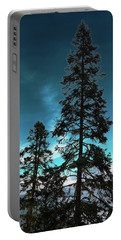 Silhouette Of Tall Conifers In Autumn Portable Battery Charger
