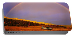 Portable Battery Charger featuring the photograph Skylane Rainbow by Tom Gresham