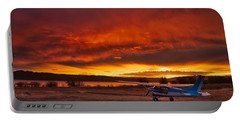 Portable Battery Charger featuring the photograph Skylane Sunrise by Tom Gresham